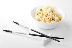 Bowl with rice and chopsticks close up Stock Photography