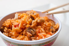 Bowl of rice with chopsticks Stock Photo
