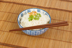 Bowl of rice with chopsticks Royalty Free Stock Images