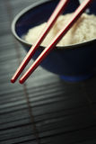 Bowl of rice and chopsticks Royalty Free Stock Images