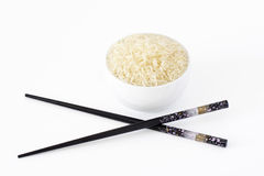 Bowl of rice with chopsticks Royalty Free Stock Photos