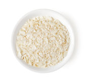 Bowl of rice flakes isolated on white, top view Royalty Free Stock Photos