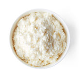 Bowl of rice flakes porridge isolated on white, from above Royalty Free Stock Photos