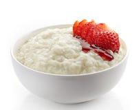 Bowl of rice flakes porridge Stock Images