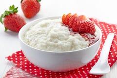 Bowl of rice flakes porridge Stock Image