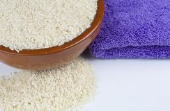 Bowl of rice and kitchen towel royalty free stock image