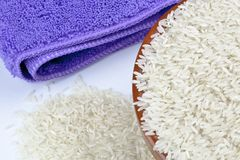 Bowl of rice and kitchen towel stock photos
