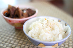 Bowl of rice with Korean beef stew. Bowl of white rice with Korean beef stew known as kalbi jim Stock Images