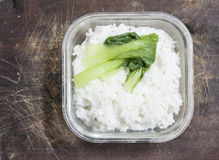 Bowl of rice on mat Stock Photography