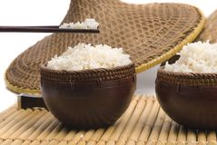 Bowl of rice with oriental sticks and hats Royalty Free Stock Images