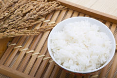 Bowl of rice and paddy Royalty Free Stock Photos