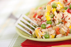 Bowl of rice with peas and red peppers Stock Photography