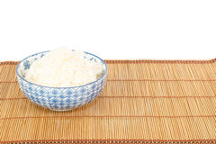 Bowl of rice on placemat in Asian style Royalty Free Stock Photography