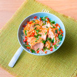 Bowl of rice with poached salmon Stock Photography