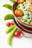 Bowl of rice with tomatoes and peas Stock Photos