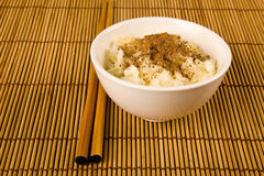 A bowl of rice and two sticks Royalty Free Stock Image