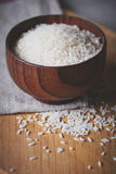 Bowl of rice on the wooden table Royalty Free Stock Photos