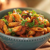 Bowl of rigatoni pasta with sausage Stock Images