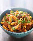 Bowl of rigatoni pasta with sausage Stock Photo