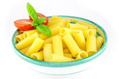 Bowl of rigatoni pasta with tomatoes and basil Royalty Free Stock Photos