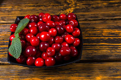 Bowl of ripe red cherries Stock Images