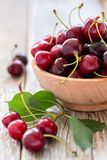 Bowl with ripe red cherries. Royalty Free Stock Photo