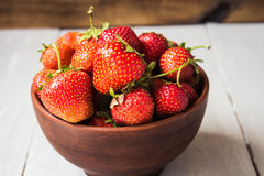 Bowl of ripe red strawberries stock photography