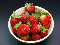 Bowl of Ripe Strawberries. Red, ripe strawberries in a ceramic bowl Stock Images
