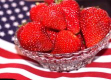 Bowl of ripe strawberries on 4th of July flag Royalty Free Stock Photos