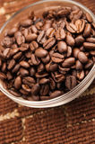 Bowl of Roasted Coffee Beans. Glass bowl filled with roasted coffee beans Stock Photos