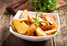 Bowl of roasted potatoes with rosemary Royalty Free Stock Photography