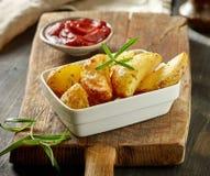 Bowl of roasted potatoes Stock Photo