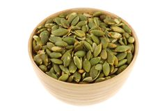 A bowl of Roasted and Salted Pumpkin seeds Stock Photography