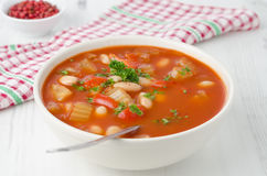 Bowl of roasted tomato soup with beans, celery and bell pepper, Stock Photo