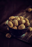 Bowl of rustic walnuts Royalty Free Stock Photos