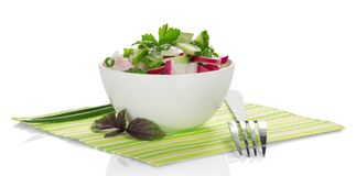 Bowl with salad, basil and fork Royalty Free Stock Images