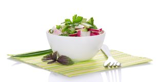 Bowl with salad, basil and fork Stock Photography