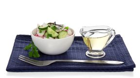 Bowl with salad cup of sunflower oil Stock Image