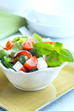 Bowl of salad with feta and green olives Stock Photo