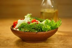 Bowl of salad  and olive oil Royalty Free Stock Photo
