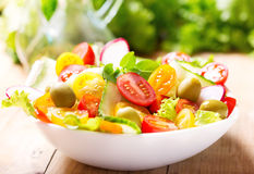 Bowl of salad with fresh vegetables stock image