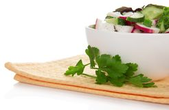 Bowl with salad and a parsley branch on napkin Royalty Free Stock Photography