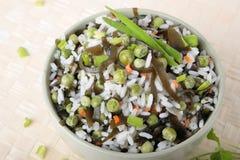 Bowl of salad with rice, laminaria and green peas Royalty Free Stock Photos