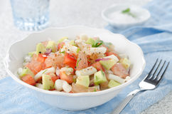 Bowl of salad with squid, avocado, grapefruit Royalty Free Stock Image
