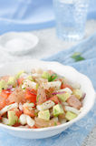 Bowl of salad with squid, avocado and grapefruit Stock Image
