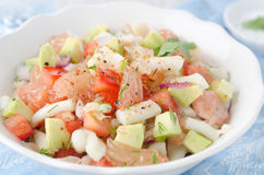 A bowl of salad with squid, avocado and grapefruit Stock Photography