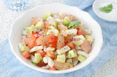 Bowl of salad with squid, avocado and grapefruit Royalty Free Stock Photography