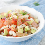 Bowl of salad with squid, avocado and grapefruit Royalty Free Stock Images