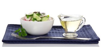 Bowl with salad, sunflower oil and fork Stock Image