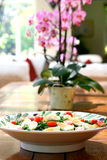 Bowl of salad on table Royalty Free Stock Photo